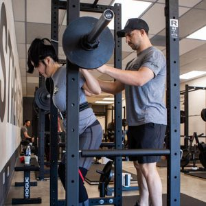 minigell correcting the squat rack position