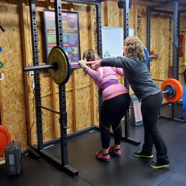 anna marie oakes-joudy fixing the squat rack position