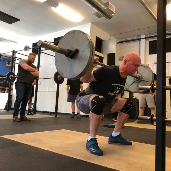 adam fangman coaching the squat