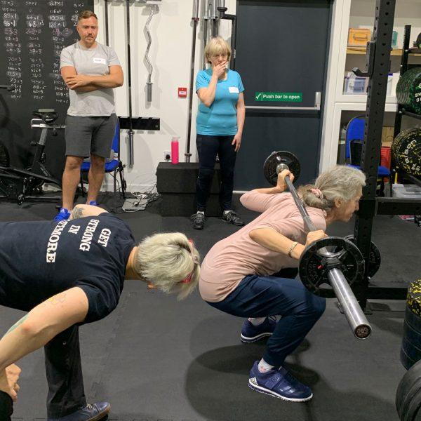 emily coaching the squat