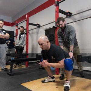 brent carter teaching the squat