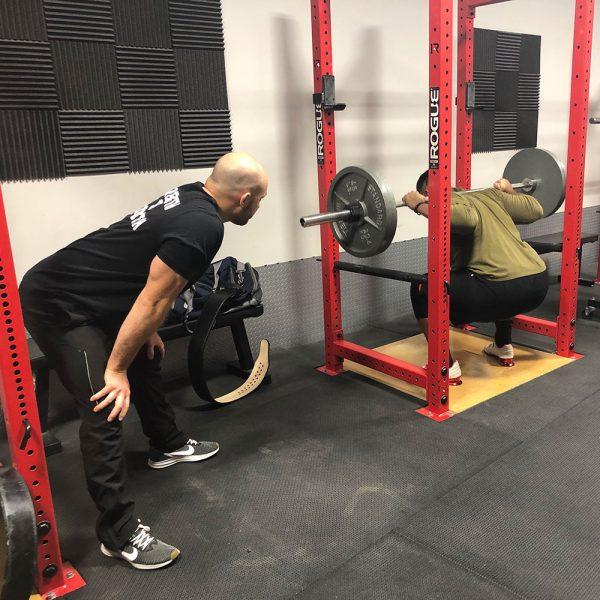 chris palladino coaching the squat
