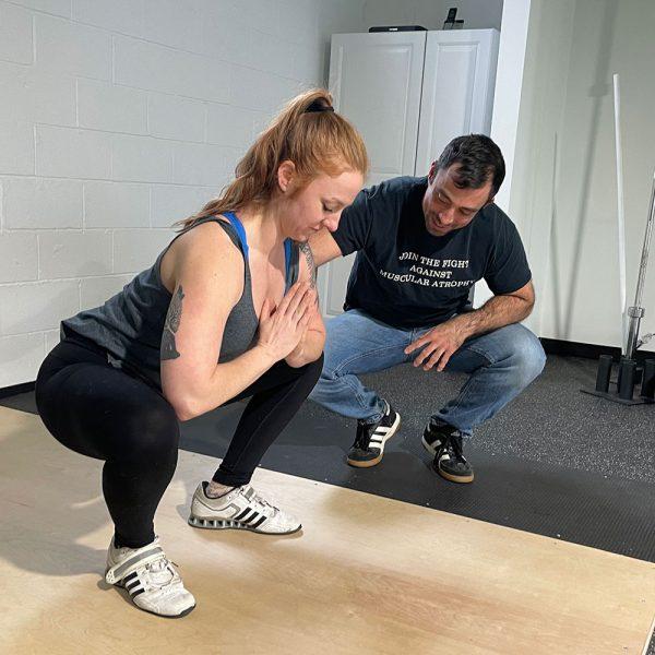 mark diffley teaching the squat