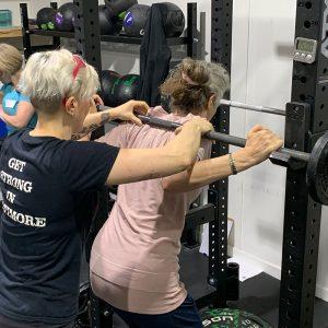 emily socolinsky coaching the squat