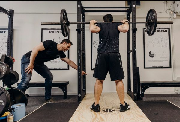 steve ross coaching a squat