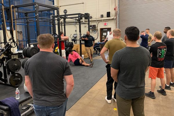 nick delgadillo teaching how to coach the squat