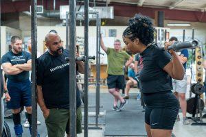 nick delgadillo teaching the squat